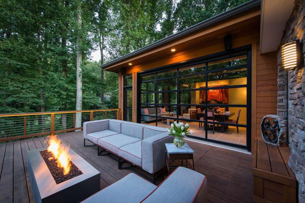Outdoor great room with glass garage door