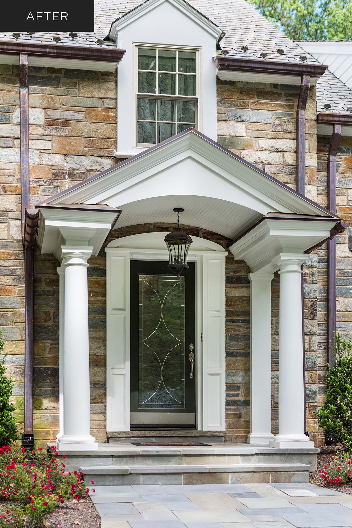 Elegant home portico with columns and leaded-glass door