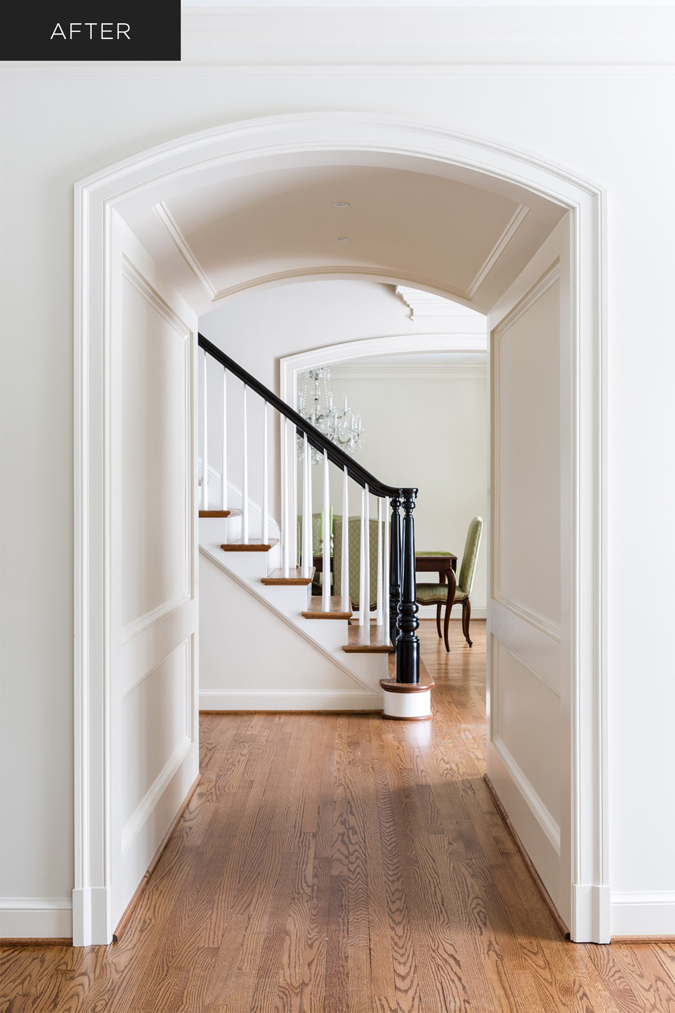 Home with curved archway hall and milled newel post on stairs