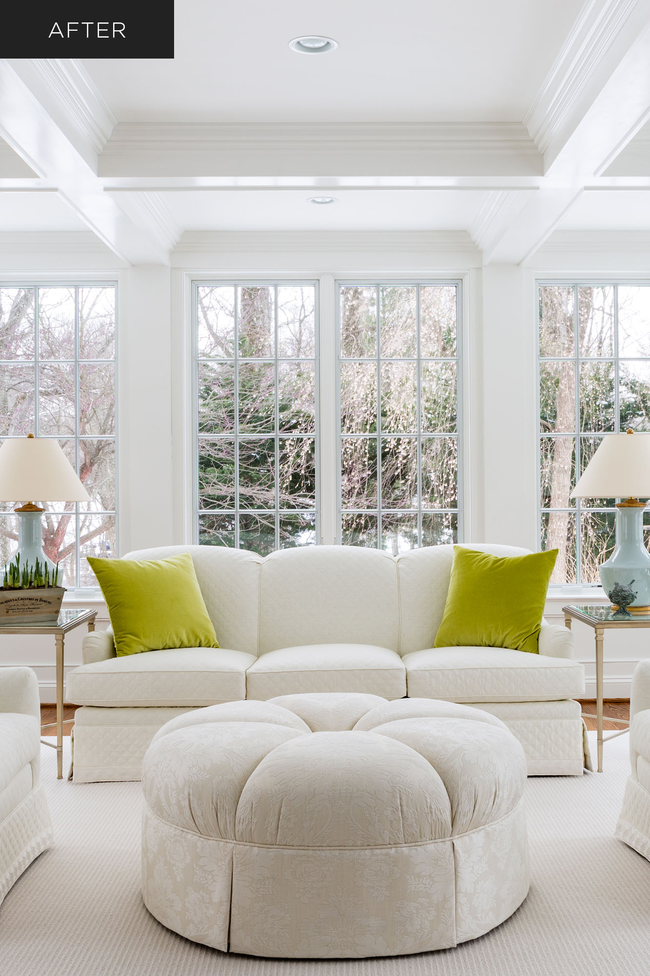 Home sunroom renovation with soffit ceiling, white furniture, white windowpanes and view of snowy landscape