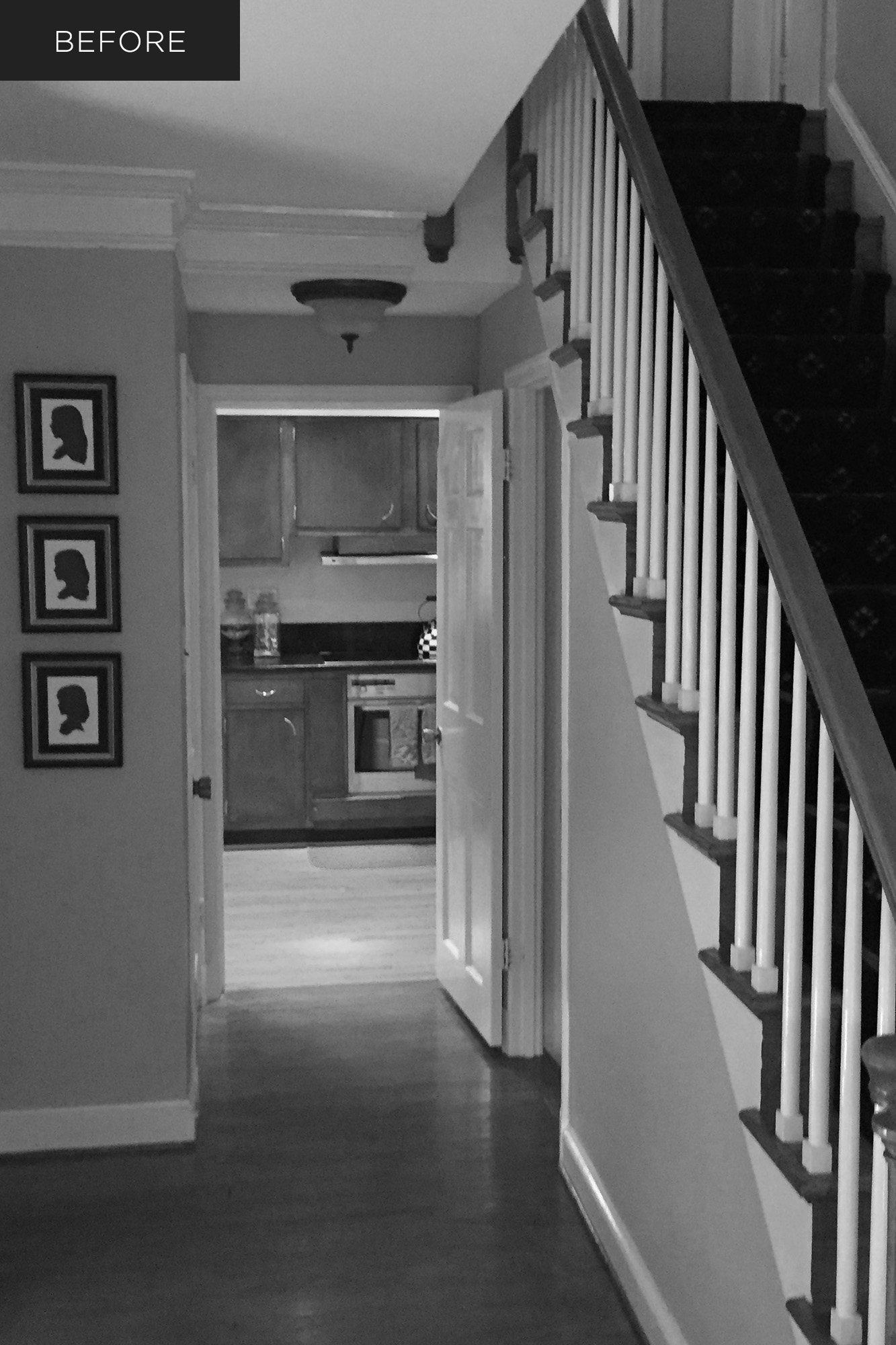 Dark front hall and kitchen before custom home renovation