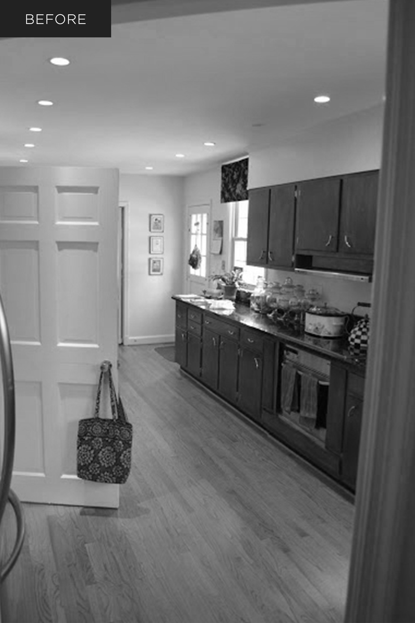 Kitchen before renovation, dark wood cabinetry, crowded galley layout