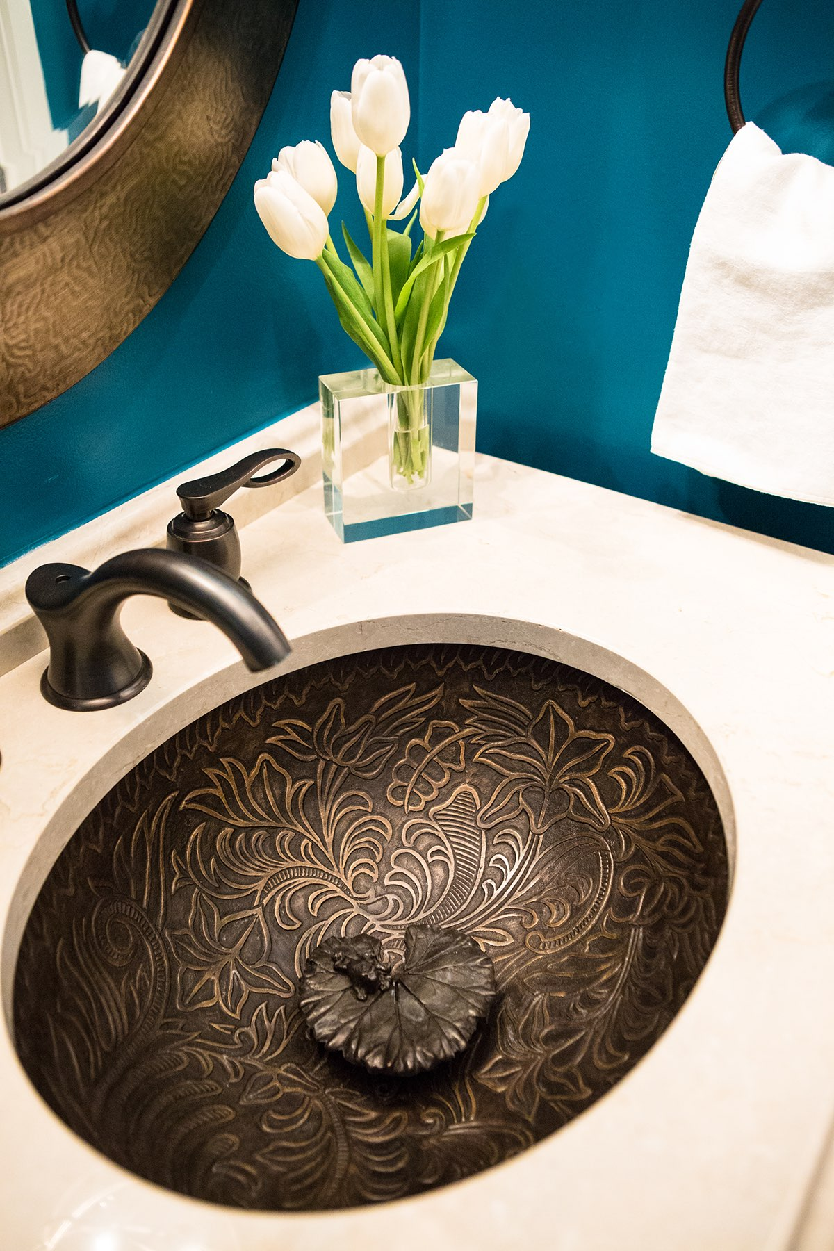 Bronze powder-room sink with lily design and lily pad sink stopper with unique tiny frog sculpture