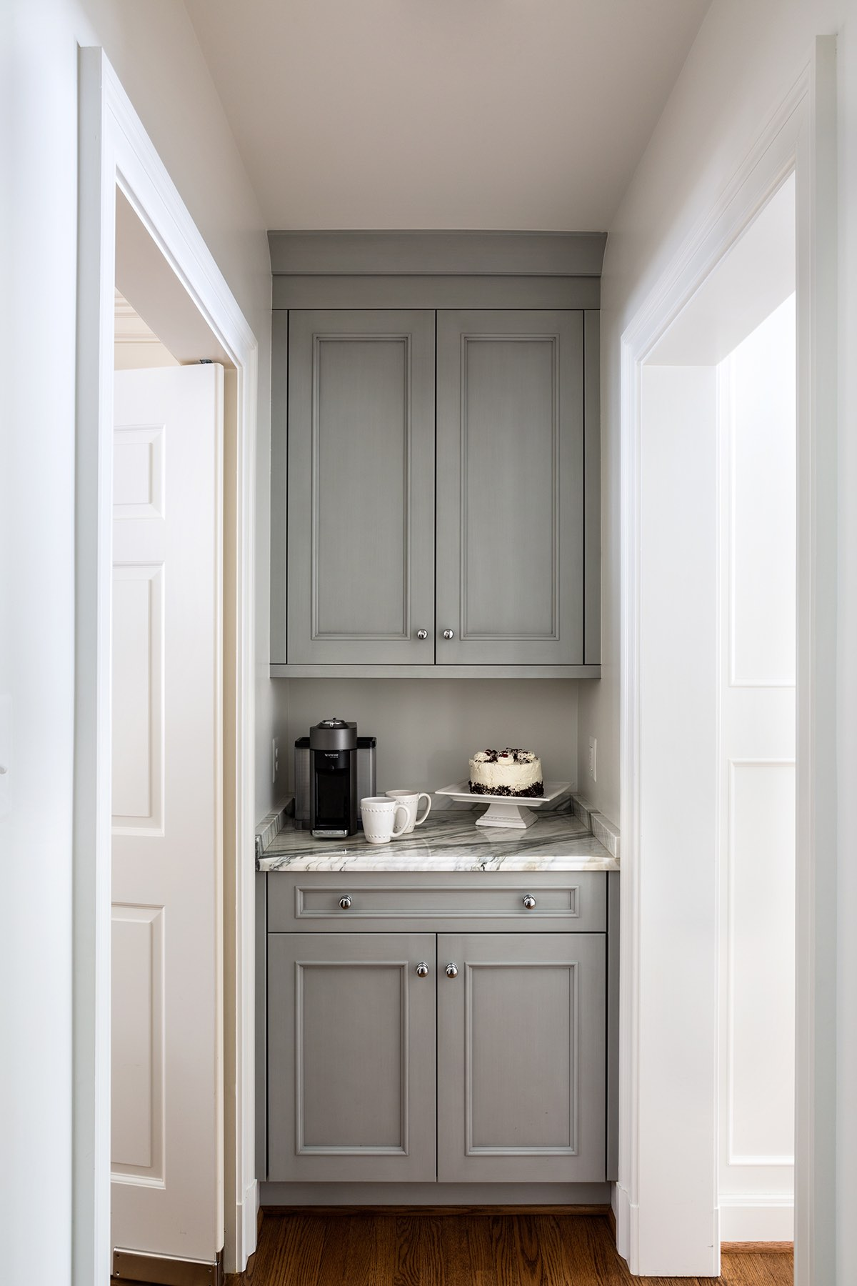 Custom-built butler's pantry off home kitchen with gray cabinetry