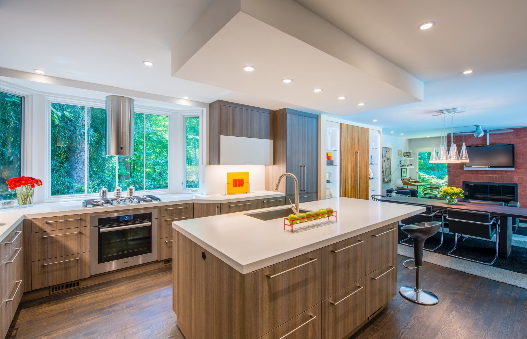 Kitchen and dining room renovation with light brown woods and white quartz counters