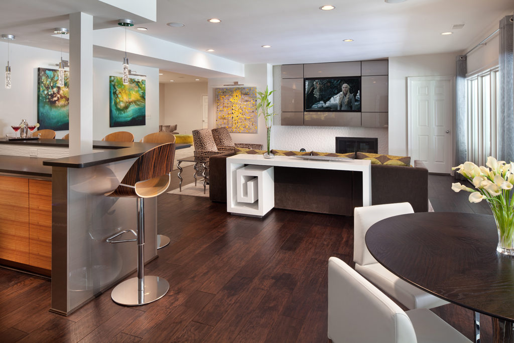 Contemporary basement renovation with full bar