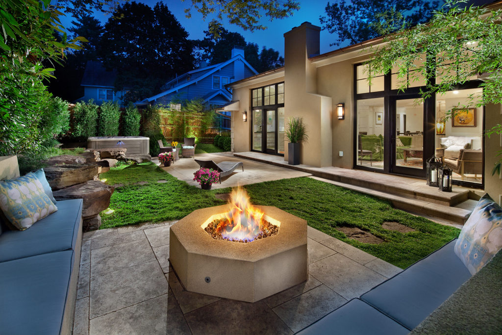 Outdoor living space with built in seating and firepit