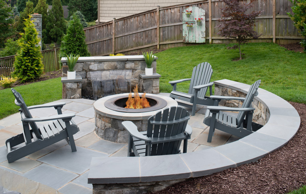 Outdoor living space with firepit and water feature