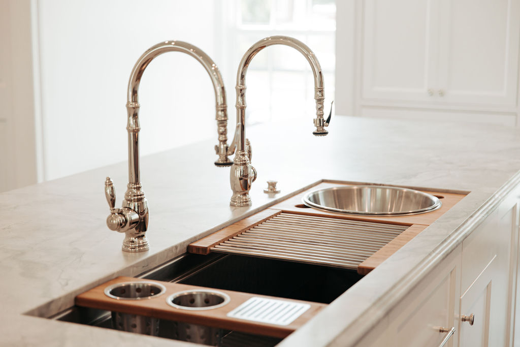 Kitchen workstation sink with double faucets